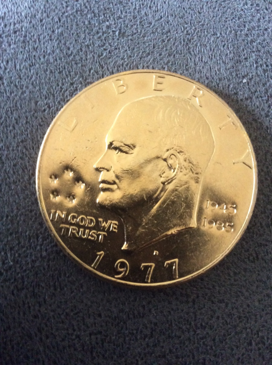 I Have An Ike Dollar Coin Covered In 24 Kt Gold Dated 1977
