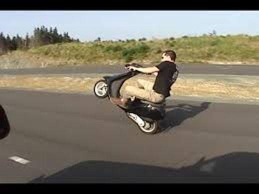 moped wheelie.jpg