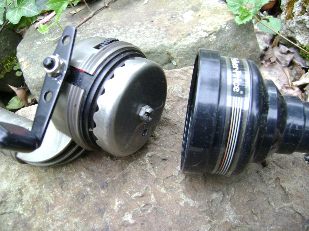 Reels built on the rod handle fishing talks us for Fisher price fishing pole