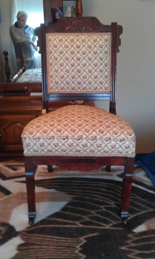 I have an antique chair with casters on the front two legs only  There is  also leaves across the top rung or back brace facing forward. Antique Chair Identity value   My Antique Furniture Collection