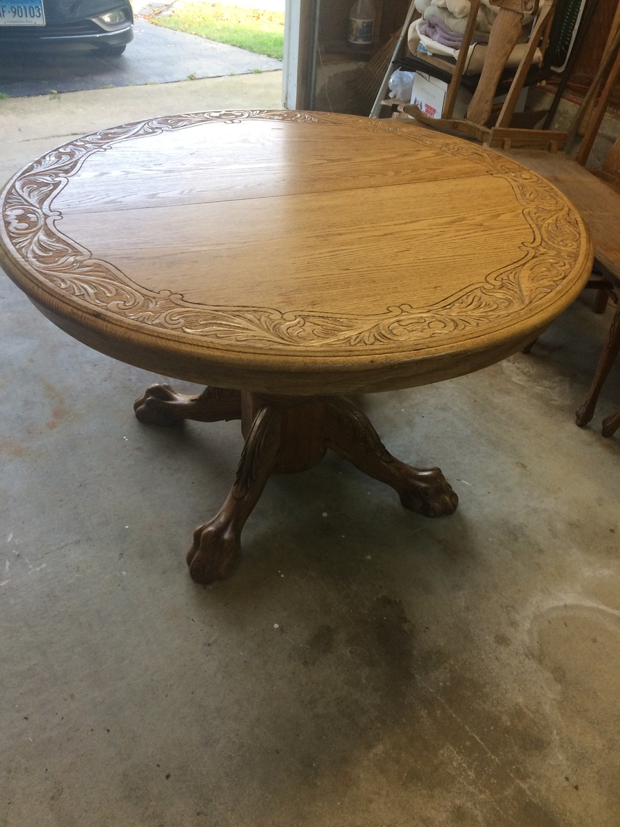 I Have A Tiger Oak Claw Foot Dining Table With A Hand Carved Top ...