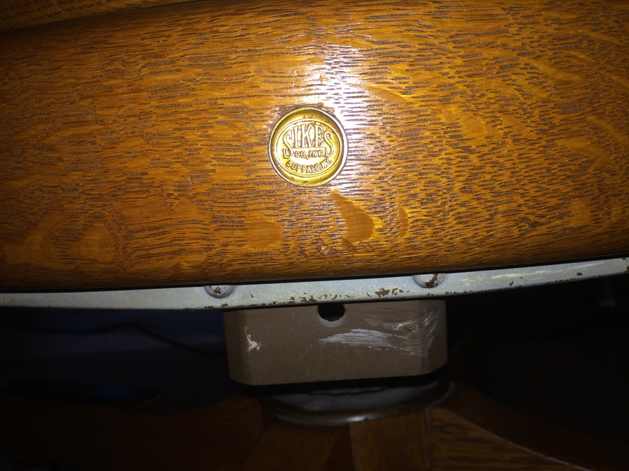 a office chair with a coin stamp saying sikes co inc
