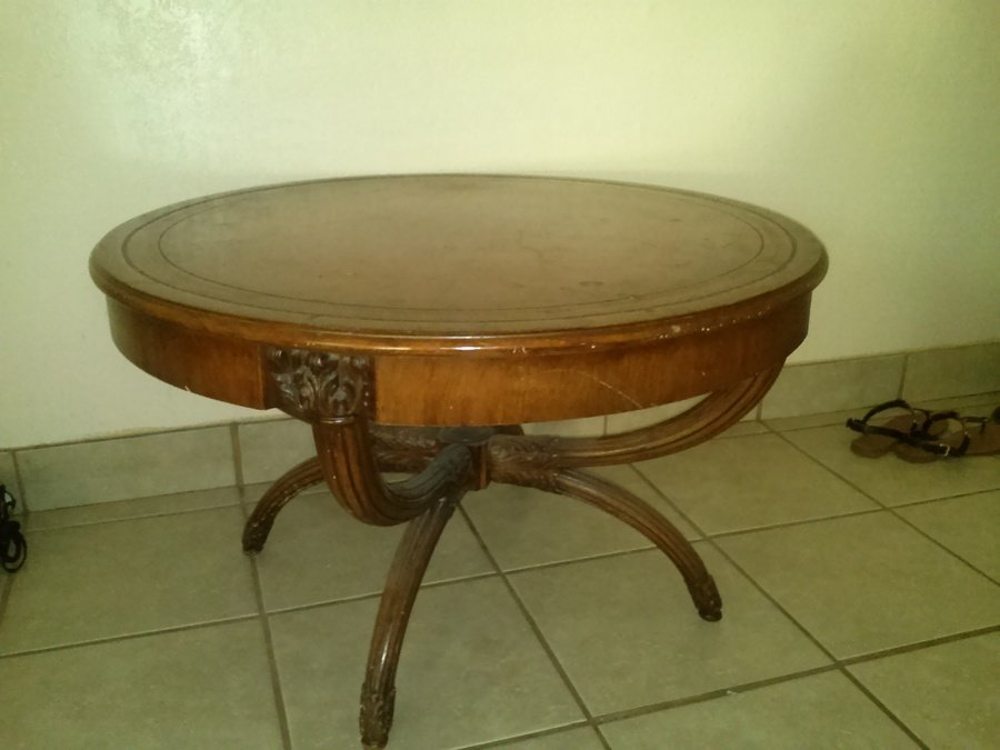 how much is my antique zangerle round coffee table worth
