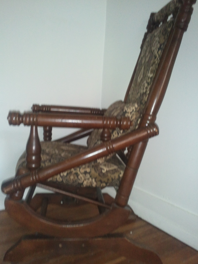 ... Antique Wooden Rocking Chair With Actual Springs U0026 Wheels On The Front.  I Was Wondering What Year It Was Made U0026 How Much Would It Be Worth?