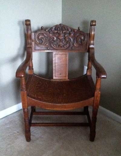 I Have A Solid Oak Antique Chair With A Carved Gargoyle