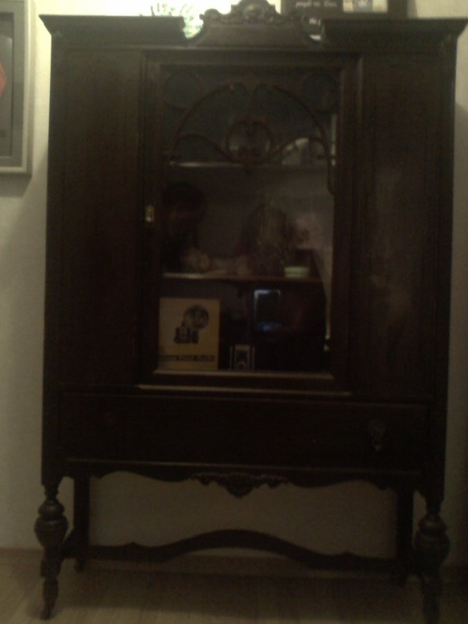 I Have An Antique China Cabinet... Think It Is 1920 To 1930. Has Wooden  Wheels . Any Idea On Its Value?