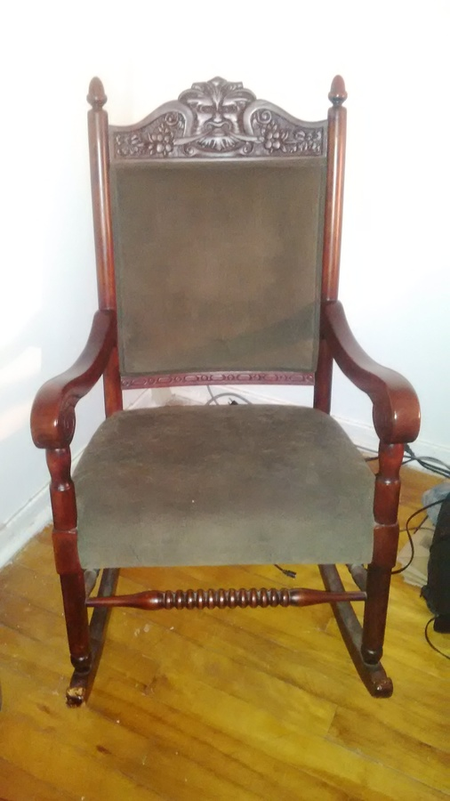 I Have A Rocking Chair With A Carved Face On The Back With