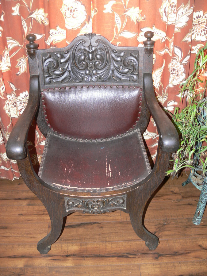 It Has A Curved Leather Seat With Nail Heads On The Front And Back. Carving  Of A Man On The Back (full Back, Leather. Arched Legs. How Much Is It Worth?