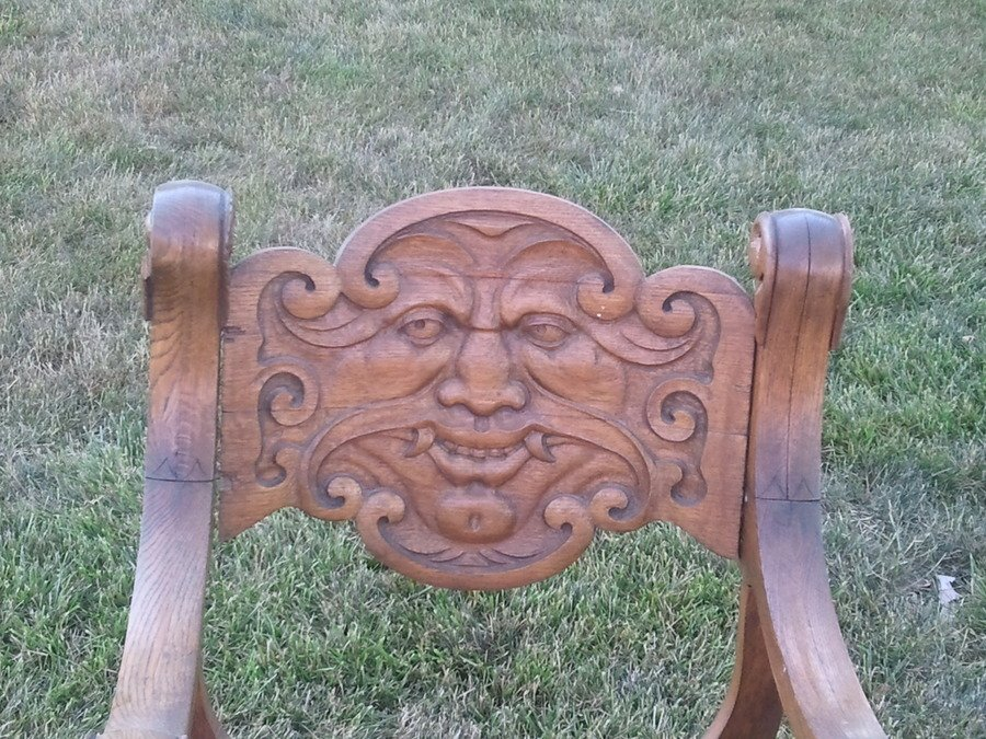 I have an antique hand carved wood chair with a face on it. The face looks like a mythological person with fangs and some kind of gargoyles on each side at ... & I Have An Antique Hand Carved Wood Chair With A Face On It. The Face ...