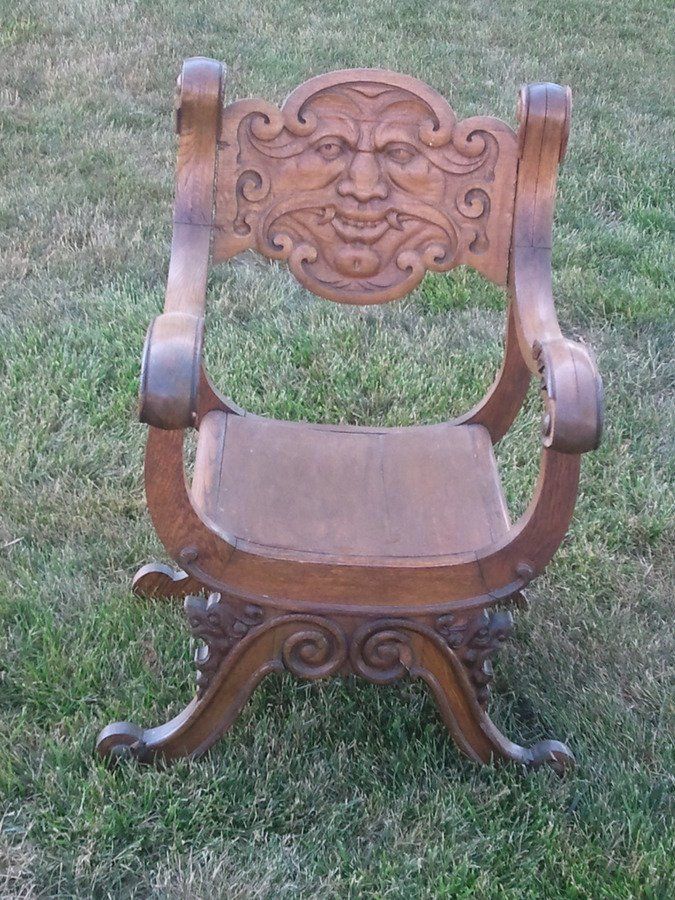 I Have An Antique Hand Carved Wood Chair With A Face On It