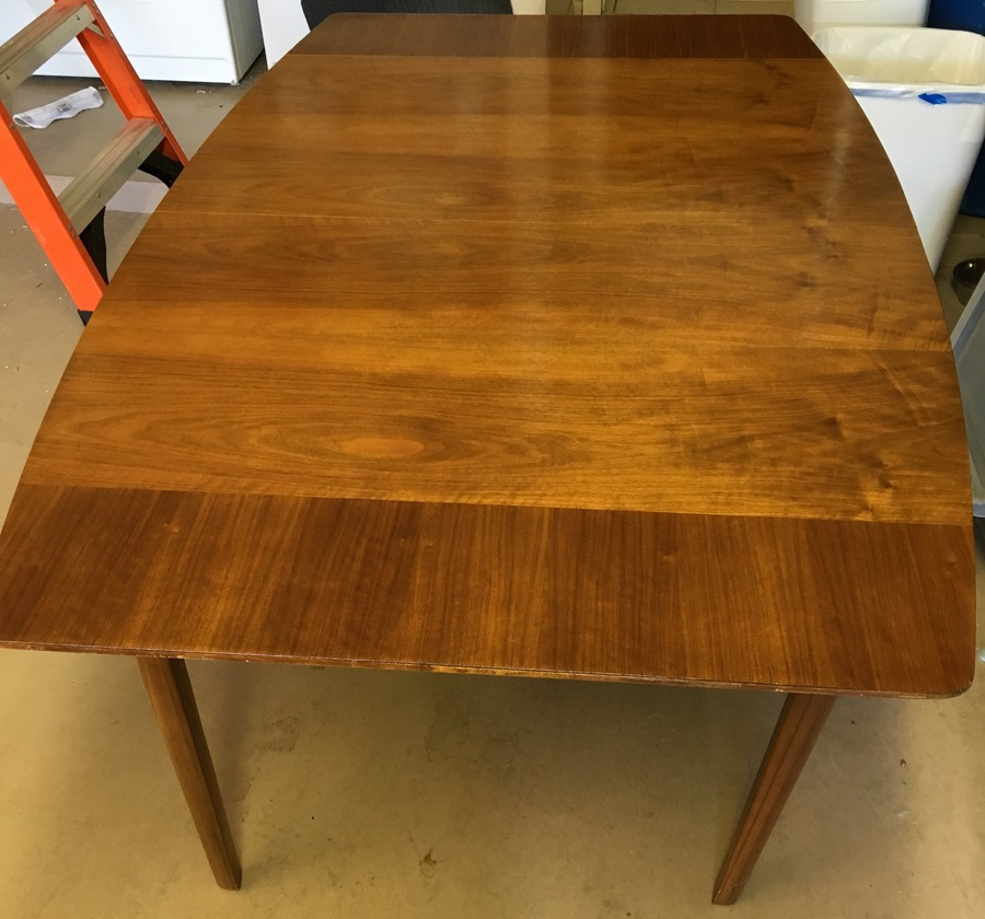 I Have A Watertown Slide Wooden Dining Table With