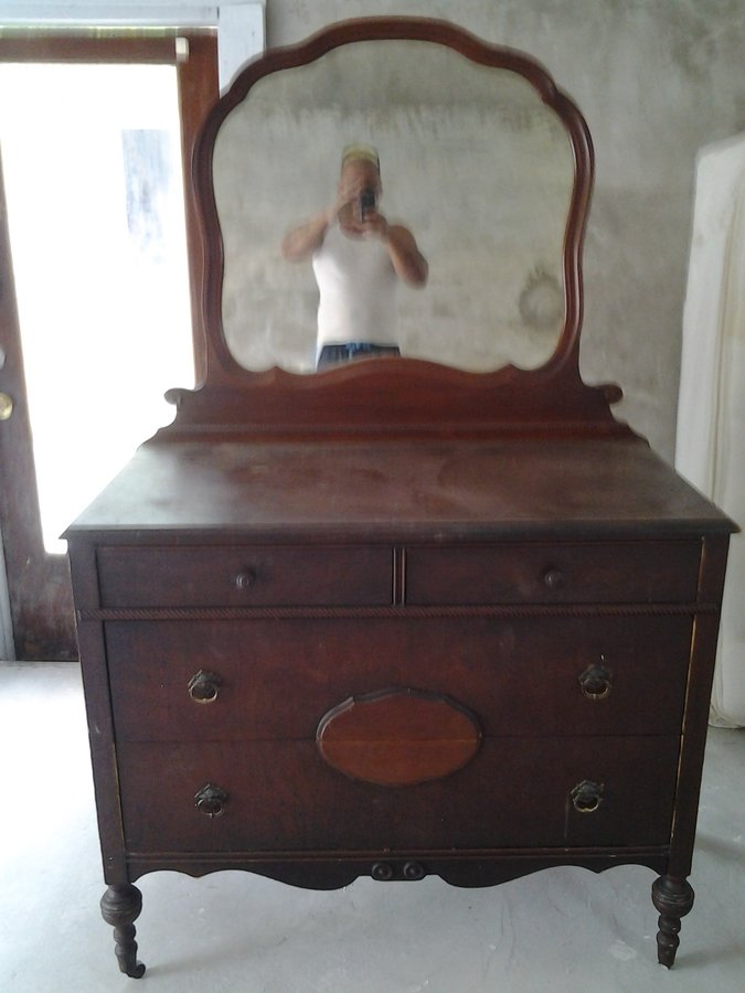 I Have An Antique Dresser That Has Wooden Wheels A Mirror