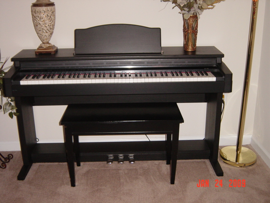 how much should i pay for a roland hp 2700 digital piano with matching benc my piano friends. Black Bedroom Furniture Sets. Home Design Ideas